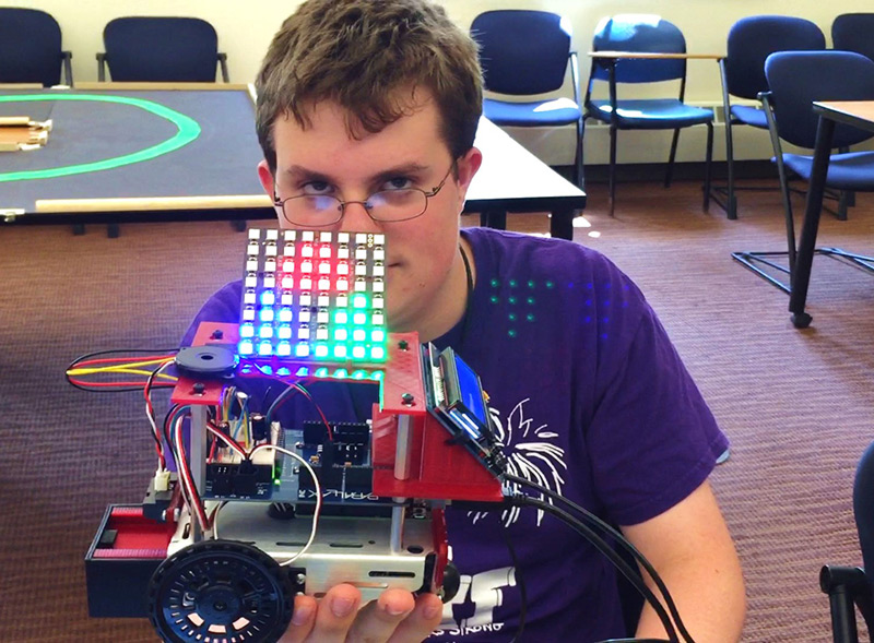 a student shows off his LED display